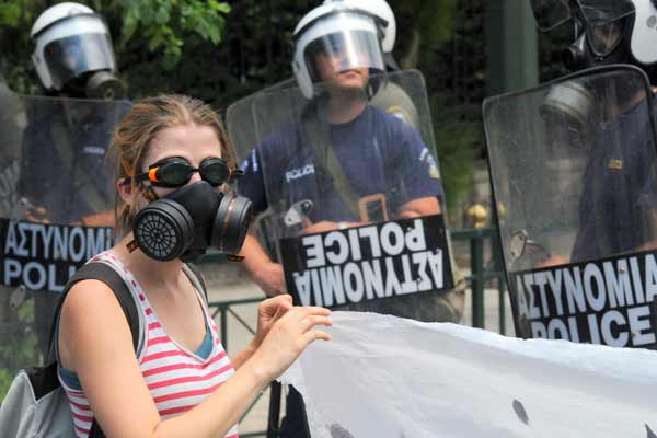 Greek protester masked against tear gas